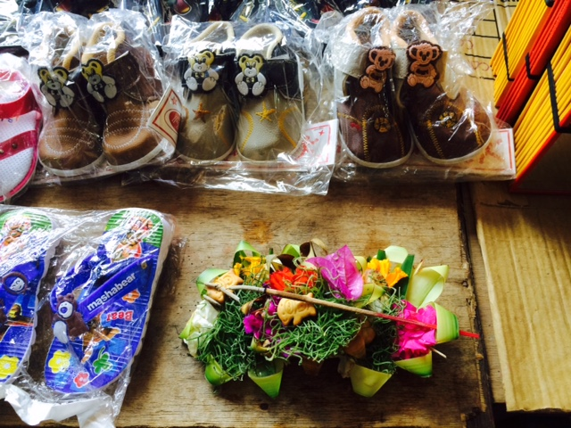 Shoes and offerings - market stall at Sukawati Market in Ubud, Bali